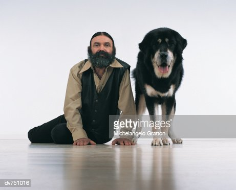 Portrait of a Bearded Man Sitting Next to A Tibetan Mastiff