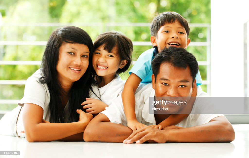 Portrait of a beautiful Asian family.
