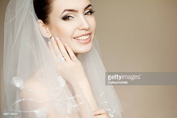 Portrait of a Beautiful bride wearing veil and smiling