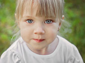 Portrait of a beautiful child with blue eyes