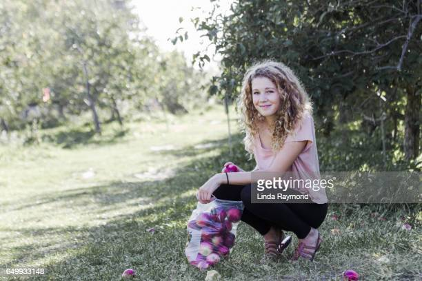 Portrait of a beautiful girl in a orchard