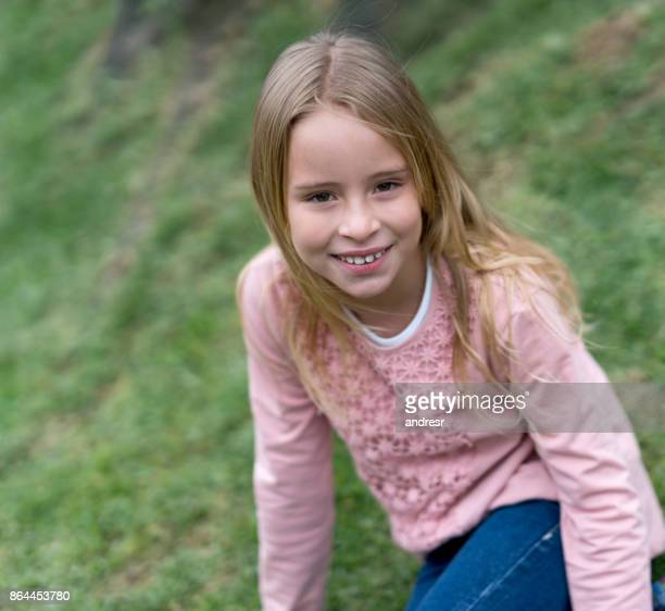 Portrait of a beautiful girl relaxing at the park