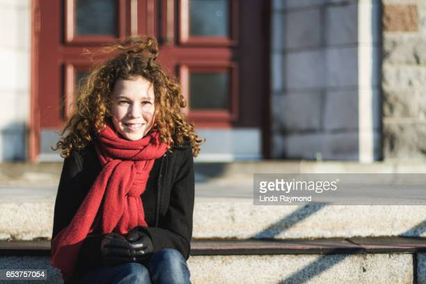 Portrait of a beautiful girl with curly hair in the wind