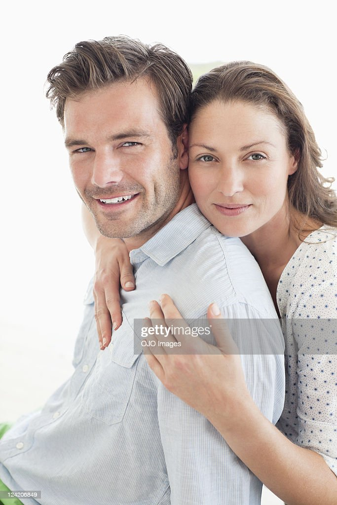 Portrait of a beautiful happy couple smiling and looking at camera : Stock Photo
