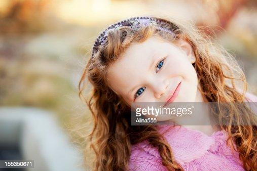 Portrait of a beautiful little girl outdoors