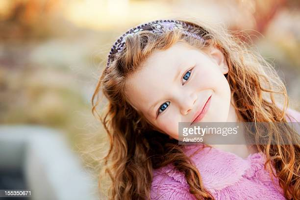 Portrait of a beautiful little girl outdoors