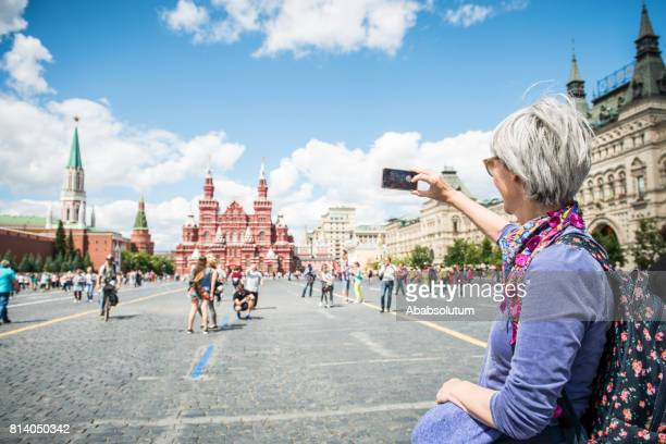 Portrait of a Beautiful Mature Woman Photographing Red Square in Moscow, Russia