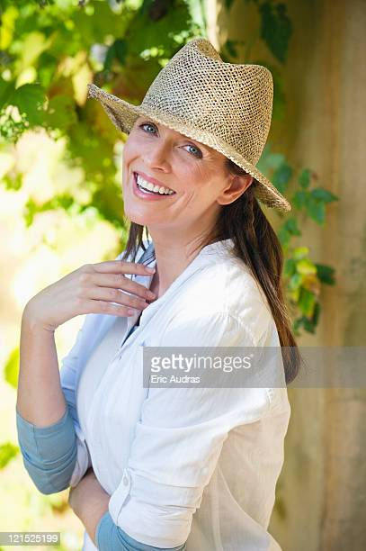 Portrait of a beautiful mature woman wearing hat and smiling