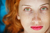 Portrait of a young beautiful redhead girl