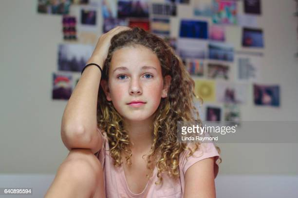 Portrait of a beautiful teenager in her bedroom