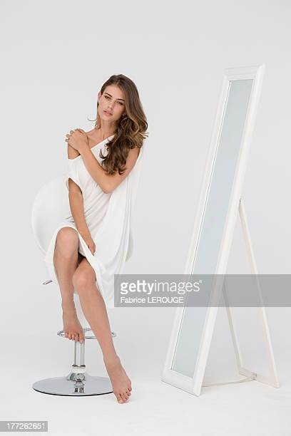 Portrait of a beautiful woman posing on a chair