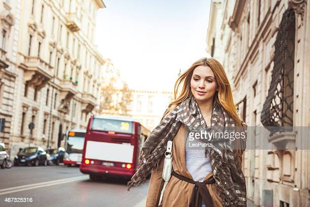 Portrait of a beautiful woman walking in the city downtown