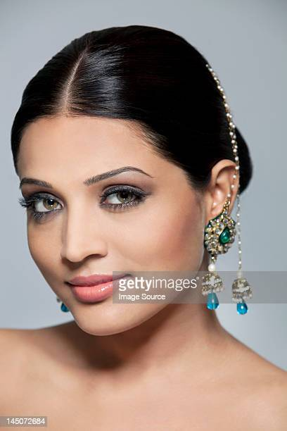 Portrait of a beautiful woman with earrings