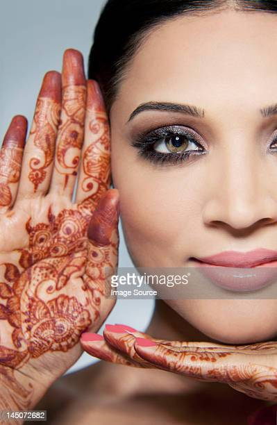 Portrait of a beautiful woman with mehndi