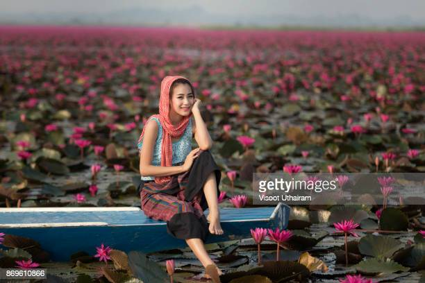 Portrait of a beautiful women on boat in lotus garden
