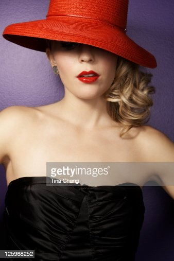 Portrait of a beautiful young lady in a red hat : Stock Photo