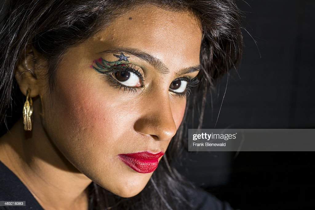A portrait of a beautiful young Muslim woman, working in a make-up shop in one of the new shopping malls.