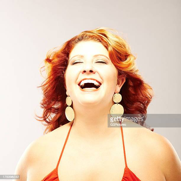 Portrait of a beautiful young woman laughing
