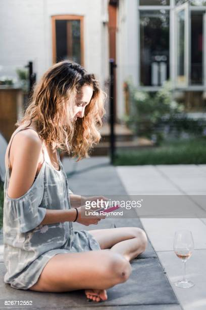 Portrait of a beautiful young woman using her cellphone