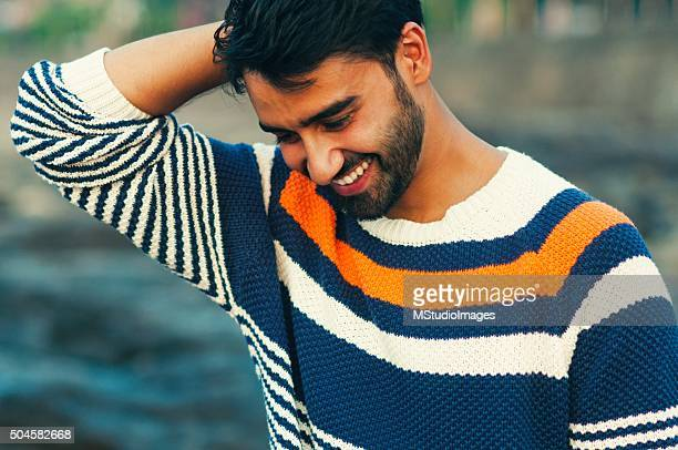 Portrait of a beautifull smiling man looking down