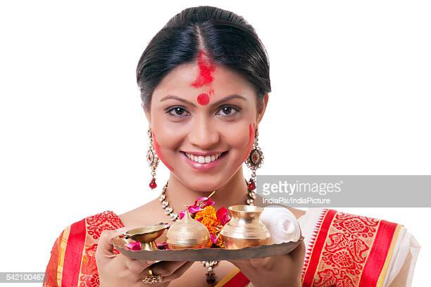 Portrait of a Bengali woman holding a puja thali