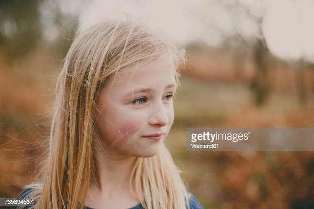 Portrait of a blond girl outdoors