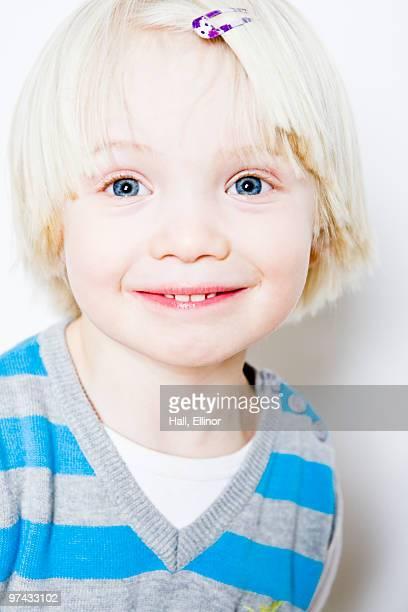 Portrait of a blond, happy boy, close-up.