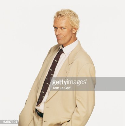 Portrait of a Blond Man Wearing a Beige Suit : Stock Photo