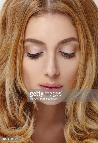 Portrait of a blonde woman looking down : Stock Photo