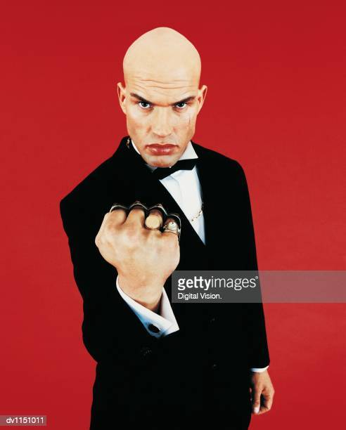 Portrait of a Bouncer With a Knuckle Duster on His Fist