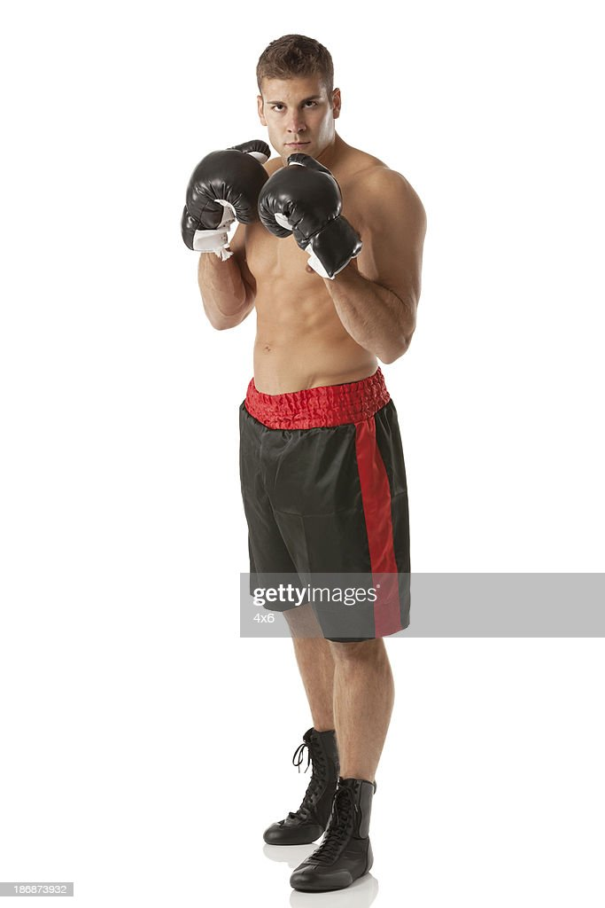 Portrait of a boxer in fighting pose : Stock Photo