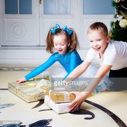 Portrait of a boy and girl  near the tree : Stock Photo