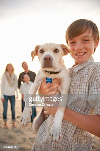 portrait of a boy and his dog at the beach : Stock Photo