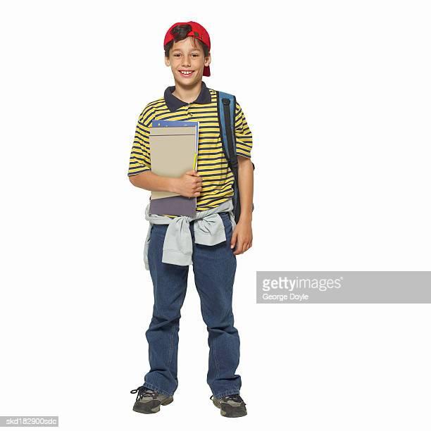 Portrait of a boy (10-12) holding a folder