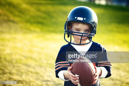 Portrait of a boy holding a football : Stock Photo