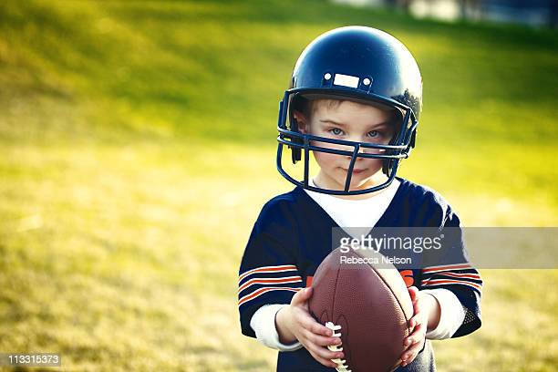Portrait of a boy holding a football