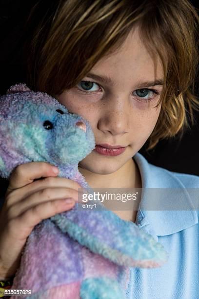 Portrait of a boy holding a teddy bear