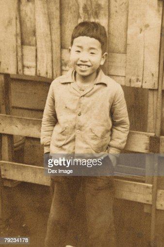 Portrait of a boy in backyard : Stock Photo