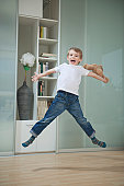 Portrait of a boy in casuals jumping in mid-air