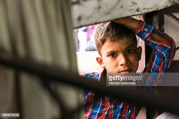Portrait of a boy in the slum of the city district Seemapuri where the Caritas and the NGO Chentanalaya support urban marginal groups on April 05...