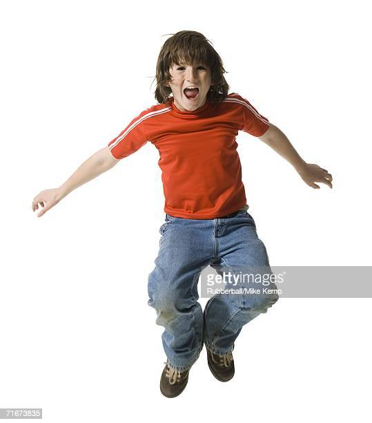 Portrait of a boy jumping in mid air