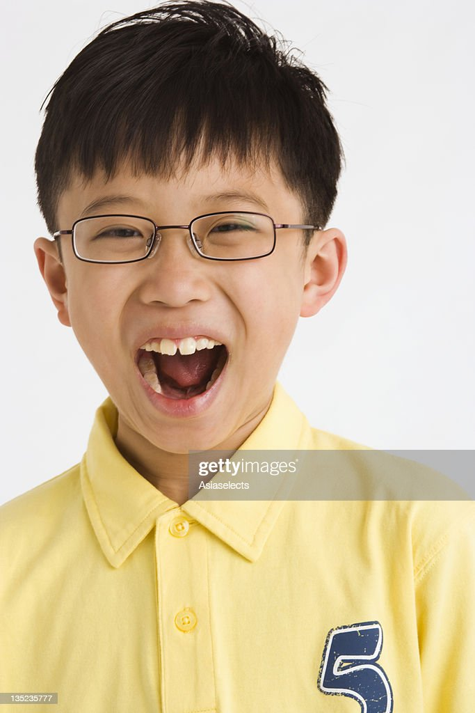 Portrait of a boy looking shocked : Stock Photo