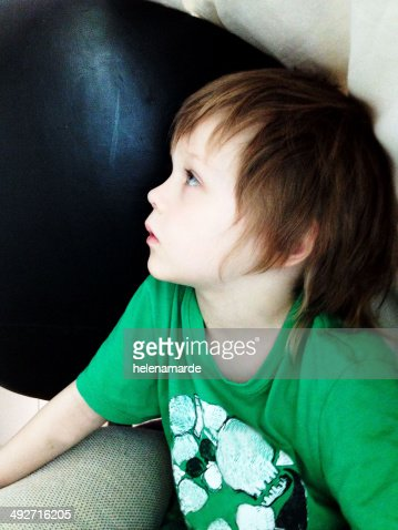 Profile of young boy (4-5) looking up