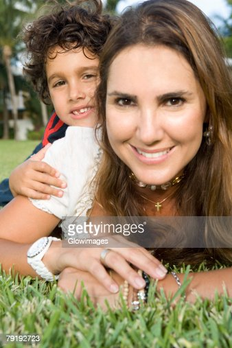 Portrait of a boy lying on the back of his mother : Stock Photo