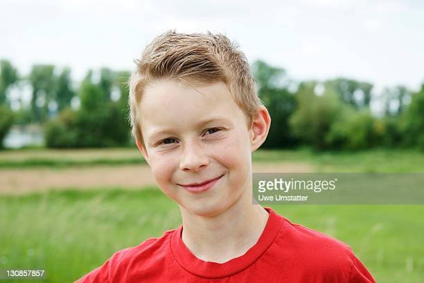 Portrait of a boy on a meadow
