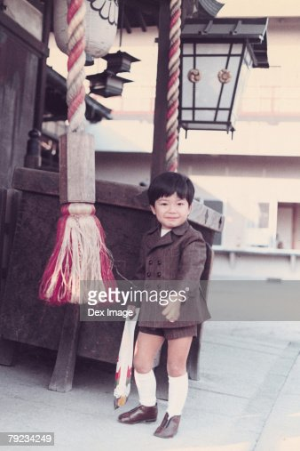Portrait of a boy outside shop : Stock Photo