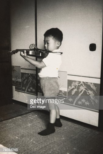 Portrait of a boy playing violin : Stock Photo