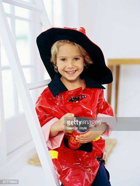 Portrait of a boy pretending to be a fireman