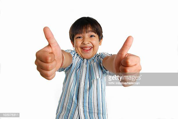 Portrait of a boy showing thumbs up sign