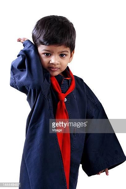 Portrait of a boy wearing a big shirt